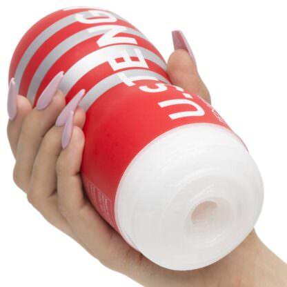 Tenga Original Vacuum CUP Stroker Sleeve Being Held In Hand